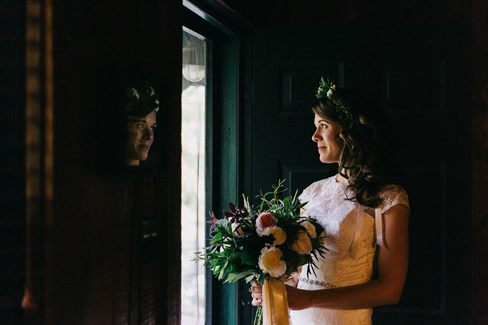 Julie gets ready for her intimate mountain wedding in Asheville, North Carolina, a favorite location of destination wedding photographers, we are the hoffmans.