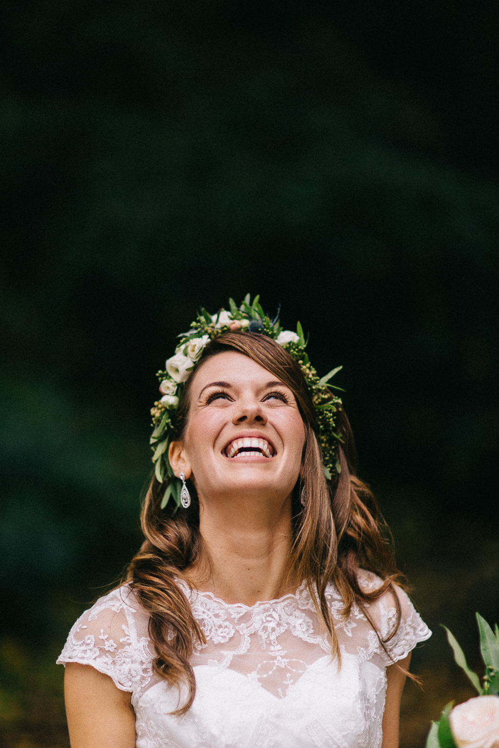 A happy bride, smiling after her elopement in the mountains on the blue ridge parkway.