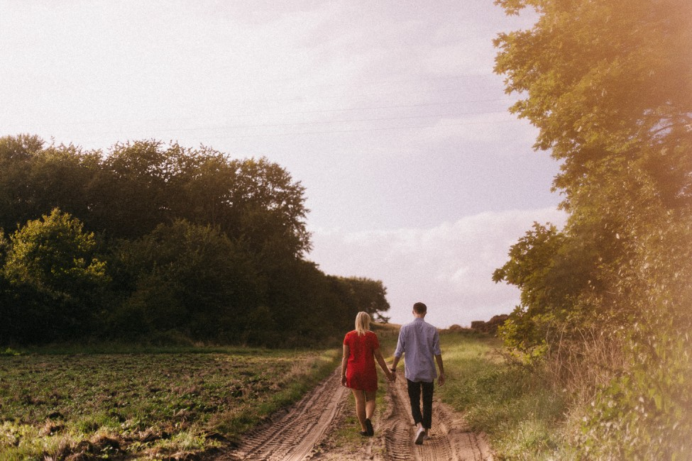 A happy couple goes on an adventure session with husband and wife adventure photographers.