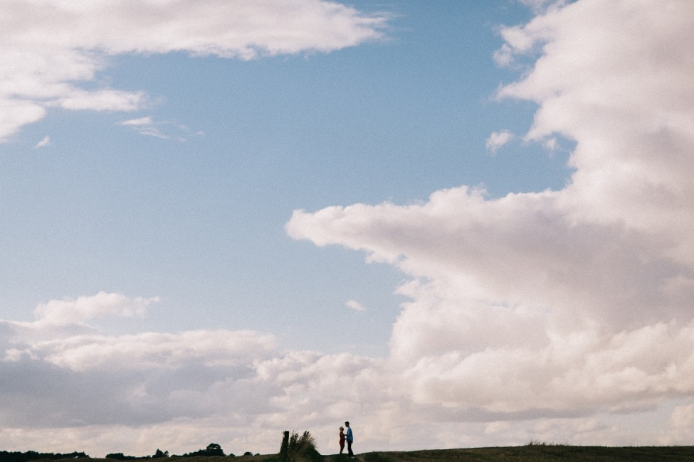 A silhouette photograph during a cloudy engagement session in Aarhus.