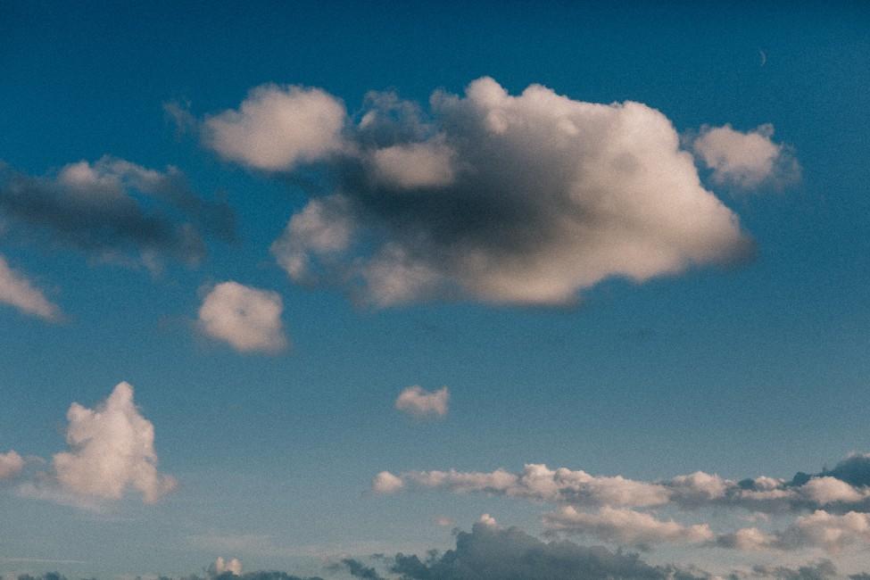 Soft clouds soaring high above YWAM Denmark.