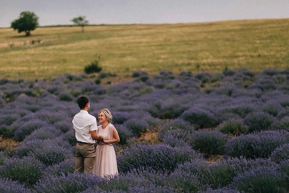 A couple in a lavender field in Moldova.