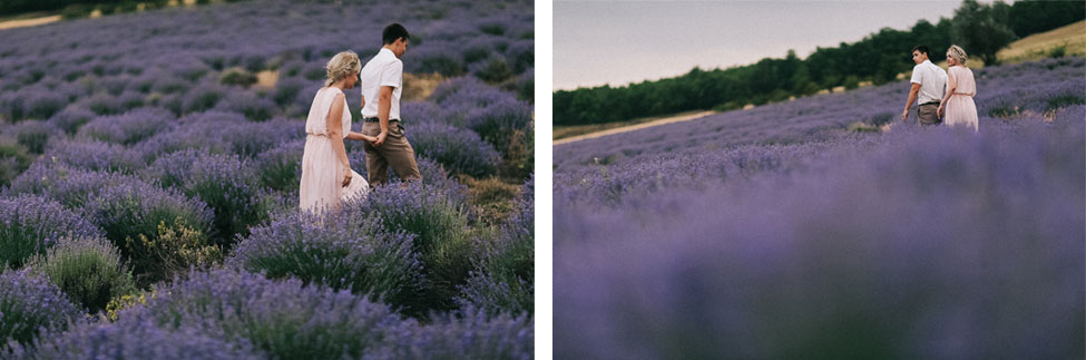 An engaged couple walking through lavender in Moldova.