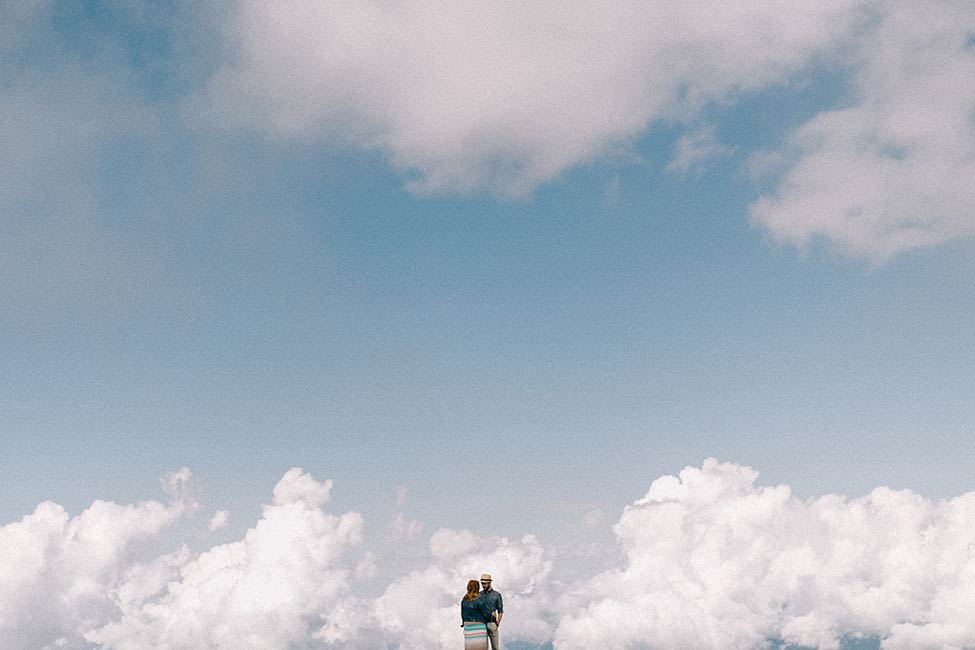 A couple in the clouds on their engagement session for a lago di garda wedding in italy.