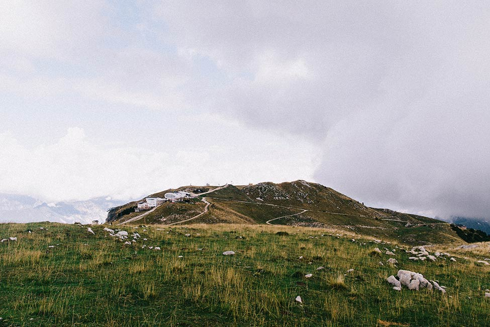 The green hills of Italy's lake district make amazing backdrops for wedding photographers.